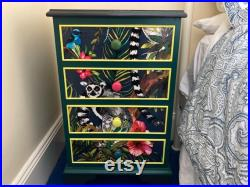 Bedside table. Children's room set of four drawers.