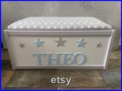 Personalised toy box with safety gas strut.